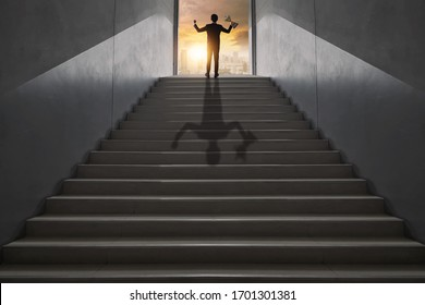 highest goal achievement and success concept, successful business man, leader businessman, winner climbing up to top of high stair way of city show hand up, holding award,  trophy of investment step