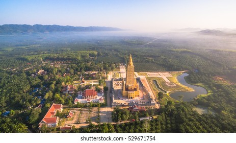 the highest pagoda in the world.pagoda has gold color. the temple and pagoda are building in the large field in the embrace of the mountains.pagoda is in Phung Nga Thailand