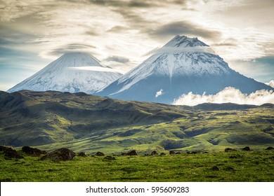 The highest volcanoes of Kamchatka: Klyuchevskoy (4835) and Stone 4585).