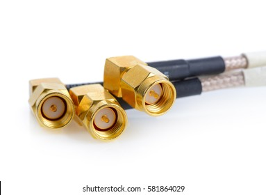 High-frequency SMA connectors isolated on white background. Gold plated pins.