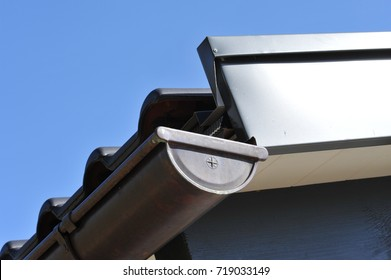 High-Grade-Steel Panel and Rain Gutter and Rainwater Pipe of Copper Metal at a House Roof