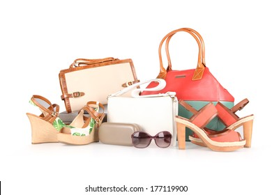high-heeled boots and leather bag