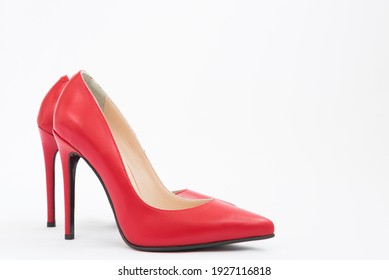 High-heeled shoes in red. Sexy shoes. White background. There is space for text