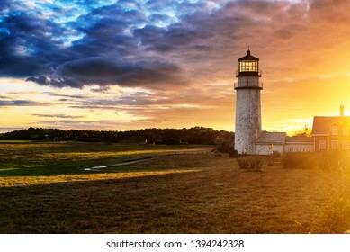 The Highland Lighthouse against a beautiful sunset in North Truro Massachusetts on the Cape Cod National Seashore.