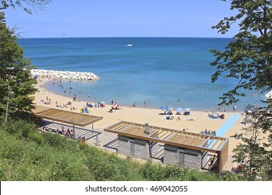 HIghland Park, IL, USA - August 2, 2015: An early afternoon summer view overlooking Lake Michigan, and part of the restored Rosewood Beach, from Rosewood Park bluff.