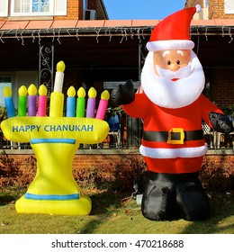 Highland Park, IL, USA - December 11, 2014: A Santa Claus and menorah outdoor winter holiday inflatable public display in front of Abbott House downtown on Central Avenue.