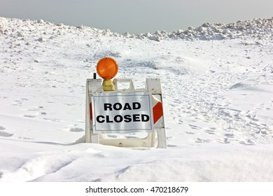 HIghland Park, IL, USA - February 7, 2015: A road closed sign in snow at Park Avenue Beach public access road.