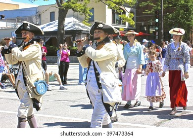 Highland Park, IL, USA - July 4, 2014: American Revolutionary War reenactors march in the Independence Day 4th of July Parade.