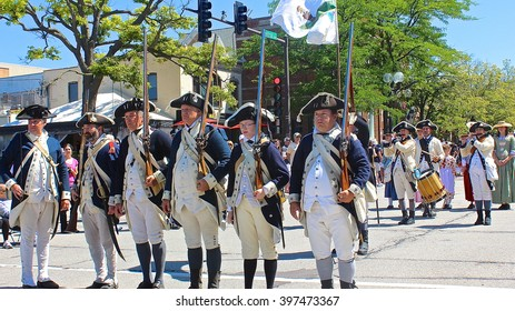Highland Park, IL, USA - July 4, 2014: American Revolutionary War reenactors march through downtown at the Independence Day 4th of July Parade.