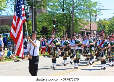 Highland Park, IL, USA - July 4, 2014: Bagpipe band marching in the Independence Day 4th of July Parade.