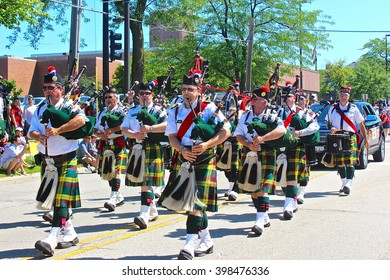 Highland Park, IL, USA - July 4, 2014: A bagpipe band marches and performs in the Independence Day 4th of July Parade.