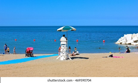 HIghland Park, IL, USA - July 23, 2015: An afternoon summer view looking east toward Lake Michigan,  including a lifeguard chair and a new breakwater at the restored Rosewood Beach.