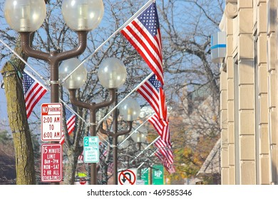 HIghland Park, IL, USA - November 10, 2015: American flags displayed downtown for Veterans Day (looking south on St. Johns Avenue from Central Avenue).