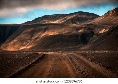 Highlands road through the lava fields in Iceland, Europe, an unique landscape looking as from another world. Iceland has offered several important film locations to big productions