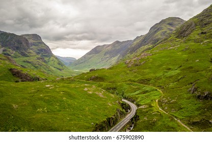 The Highlands, Scotland. Elevated drone image of a road running deep into the Grampian Mountains of the Scottish Highlands.
