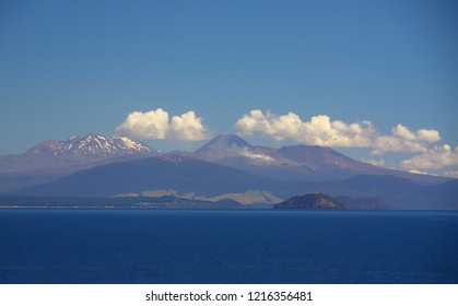 Highlight in the Tongariro National Park in New Zealand on the North Island: lake Taupo with Mount Ruapehu, Mount Ngaruahoe and Mount Tongariro