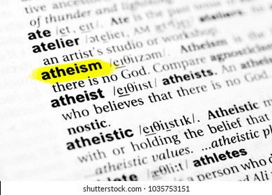 "Highlighted English word ""atheism"" and its definition in the dictionary."