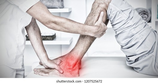 Highlighted pain against cropped image of hand examining calf muscle