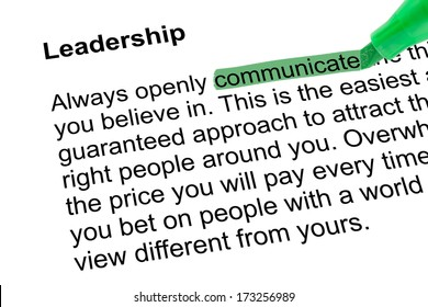 Highlighted word communicate for Leadership with green pen over white paper. Isolated white background.