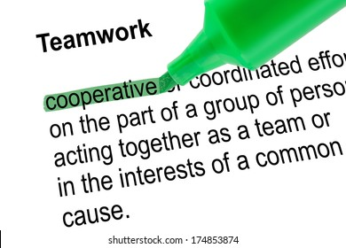 Highlighted word cooperative for Teamwork with green pen over white paper. Isolated white background.