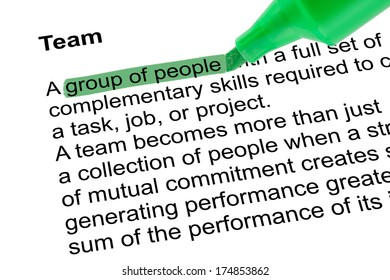Highlighted word group of people for Team with green pen over white paper. Isolated white background.
