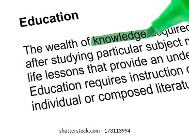 Highlighted word knowledge for Education with green pen over white paper. Isolated white background.