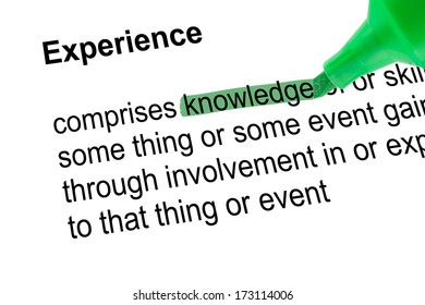 Highlighted word knowledge to Experience with green pen over paper. Isolated white background.