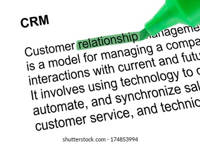 Highlighted word relationship for CRM with green pen over white paper. Isolated white background.