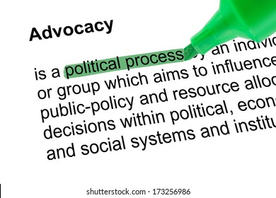 Highlighted words  political process for Advocacy with green pen over white paper. Isolated white background.