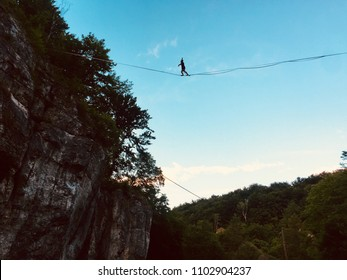 Highline or slackline between rocks and forest in Poland