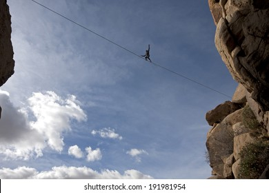 Highline walker in blue sky, Joshua Tree National Park