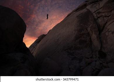 Highline walker over granite domes with nice sunset, Joshua Tree National Park