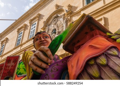 Highly colourful paper mache floats fill the streets of Valletta with color during the 2017 Valletta Carnival Festival, Auberge d'Italie, Valletta, Malta, February 2017