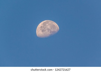 Highly detailed half moon during daytime on the blue sky, Crescent moon in daytime