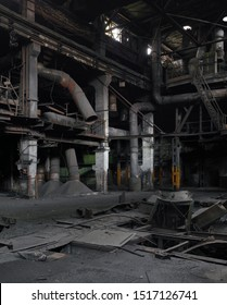 Highly detailed vertical panorama of an abandoned factory interior with pipes and rusty metal structures.