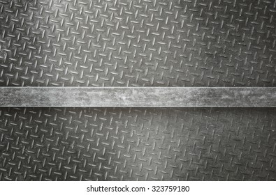 A highly detailed vintage grunge metal diamond background texture with metal bar for your text.
