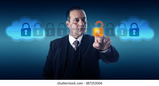 Highly focused businessman is unlocking a data packet within an intercloud information stream. Technology management, internet security, service provider interoperability and cloud computing concept.