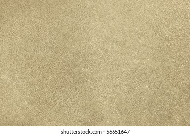 Highly mottled metallic surface in gold and yellow hues