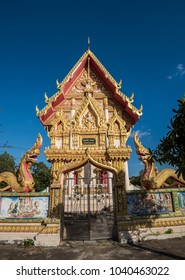 Highly ornate and decorative temple buildings in Thailand Asia. Showing use of sculpture and gold.Thailand temples often have carvings done by the monks that depict local and historical legions.