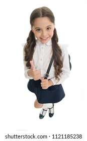 Highly recommend. Schoolgirl shows thumb up gesture, isolated white background. Girl happy smiling recommendation. Child pupil school uniform highly recommend with thumb up gesture. Make right choice.