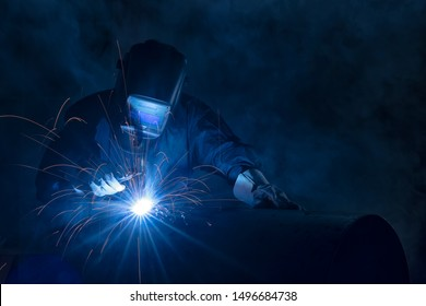 Highly skilled welder workers are welding in the construction site in the factory.