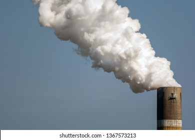 Highly smoking chimney as a sign of air pollution