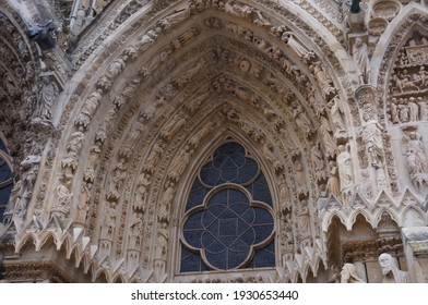 Highly sophisticated stone sculptures, lavish decorations and statuary adorning the archivolts of the porch of the Gothic Cathedral Notre-Dame of Reims, a World Heritage Site in the North of France