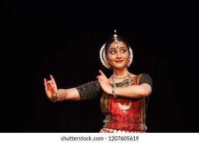 A highly talented junior Odissi dancer looks at lord krishna playing the flute during the Odissi evening recital event on October 19,2018 at Bharatiya Vidhya Bhavan in Bengaluru,India