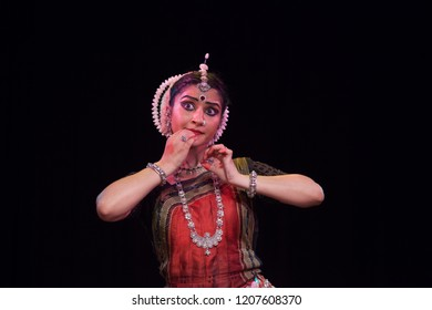 A highly talented junior Odissi dancer looks at the eyes of baby lord krishna during the Odissi evening recital event on October 19,2018 at Bharatiya Vidhya Bhavan in Bengaluru,India