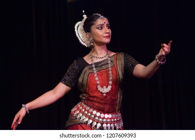 A highly talented junior Odissi dancer pointing towards the lord eating butter the Odissi evening recital event on October 19,2018 at Bharatiya Vidhya Bhavan in Bengaluru,India