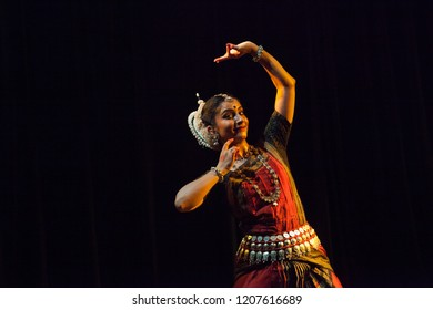 A highly talented junior Odissi dancer looks at the lords deep eyes during the Odissi evening recital event on October 19,2018 at Bharatiya Vidhya Bhavan in Bengaluru,India