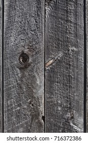 Highly textured, old weathered barn board as a background.