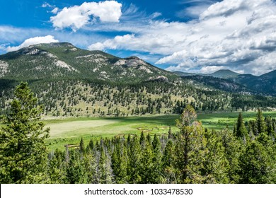 High-mountainous green spring valley in the Rocky Mountains and the blue sky, Colorado. Journey through the US National Parks