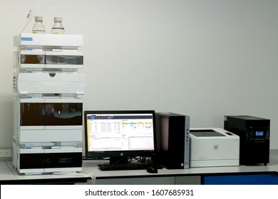High-performance liquid chromatography (HPLC) instrument with desktop computer in laboratory, the concept of chemical analysis equipment. Bangkok, Thailand. On Nov 7, 2019.
